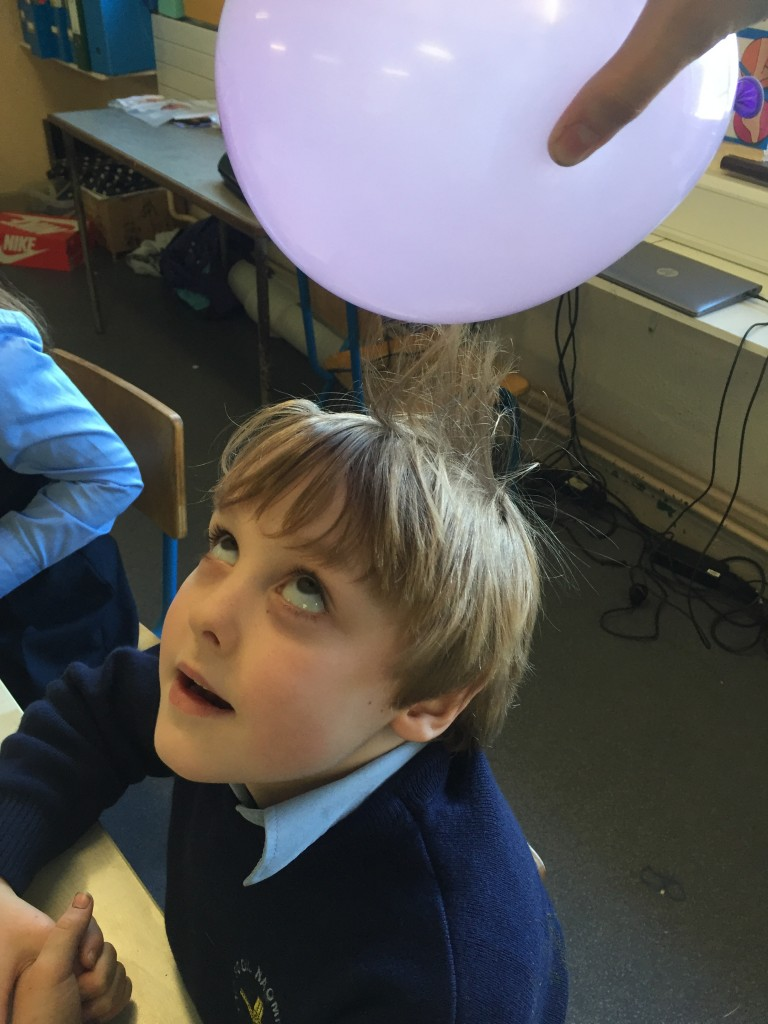 Exploring static electricity using balloons.