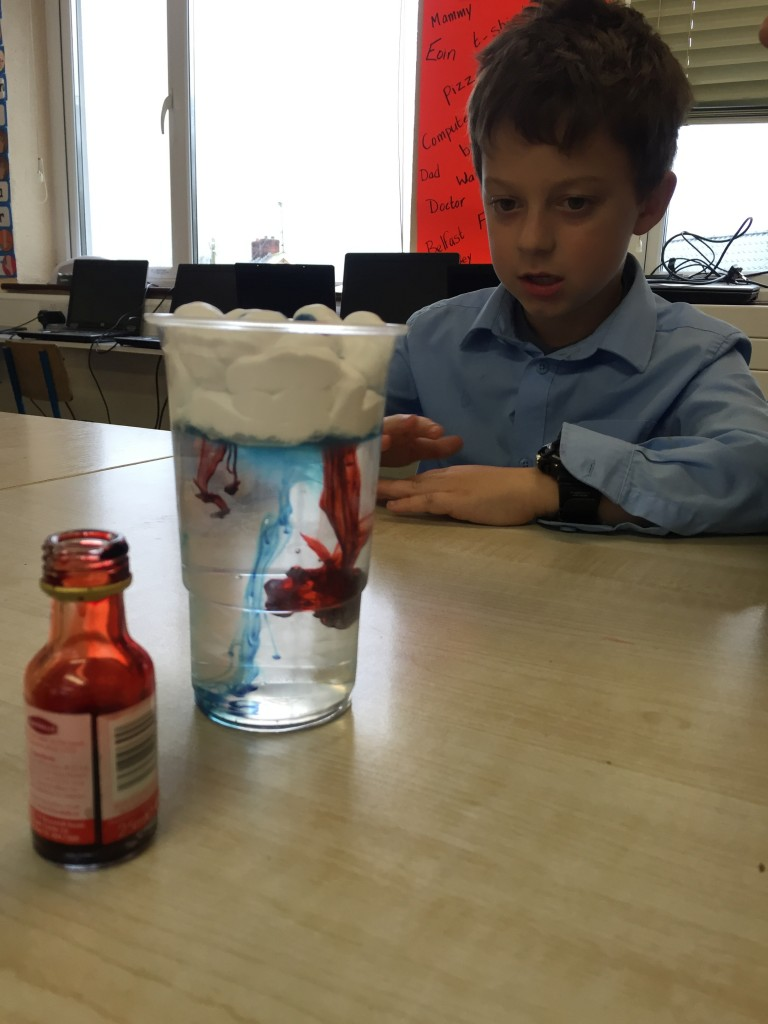 Making rain clouds using shaving foam, water and food colouring!