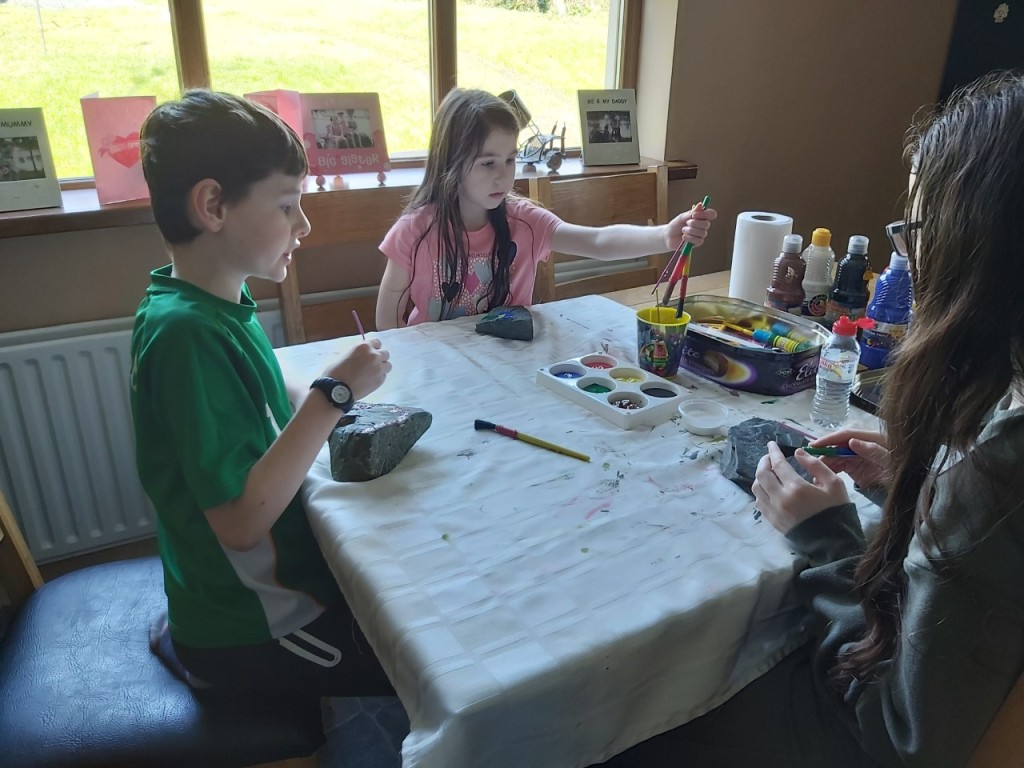 The Fay family taking a break from school work to do some rock painting.