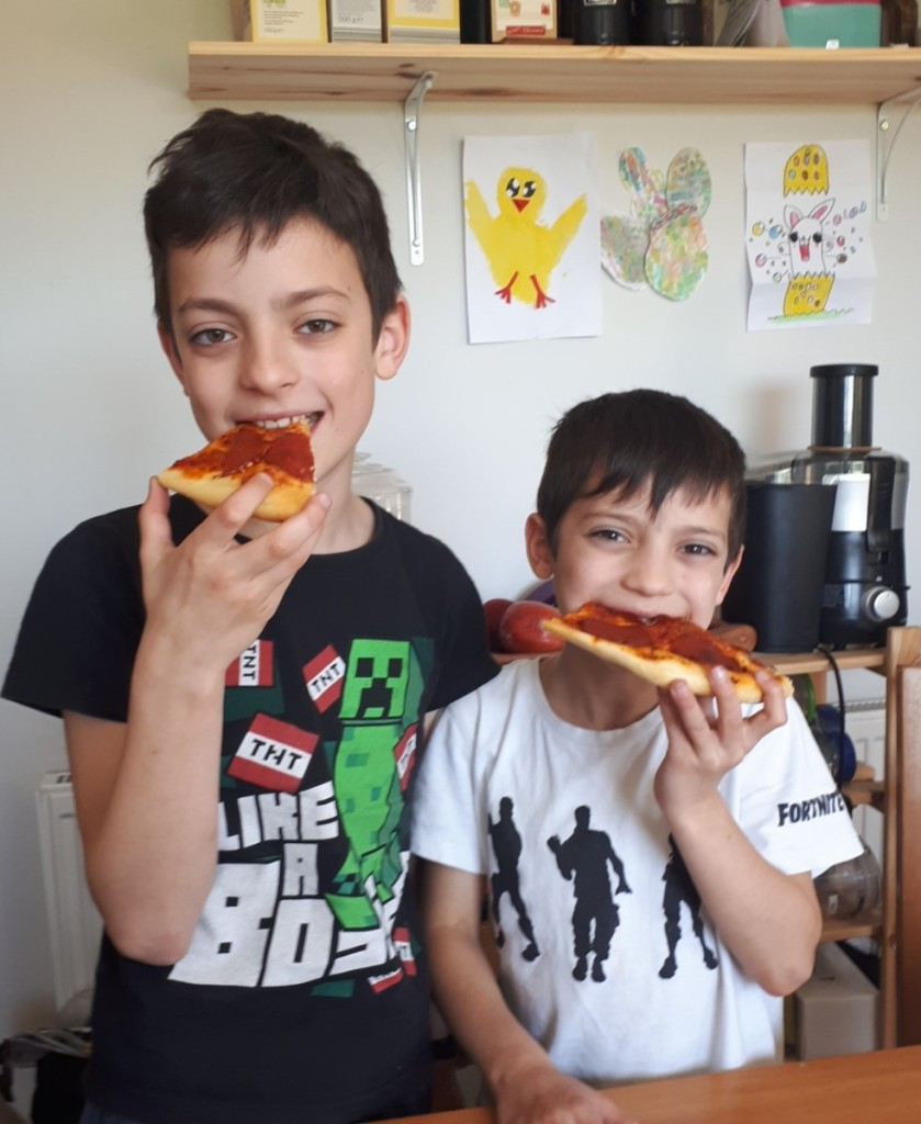 Adam and David eating their homemade pizza.