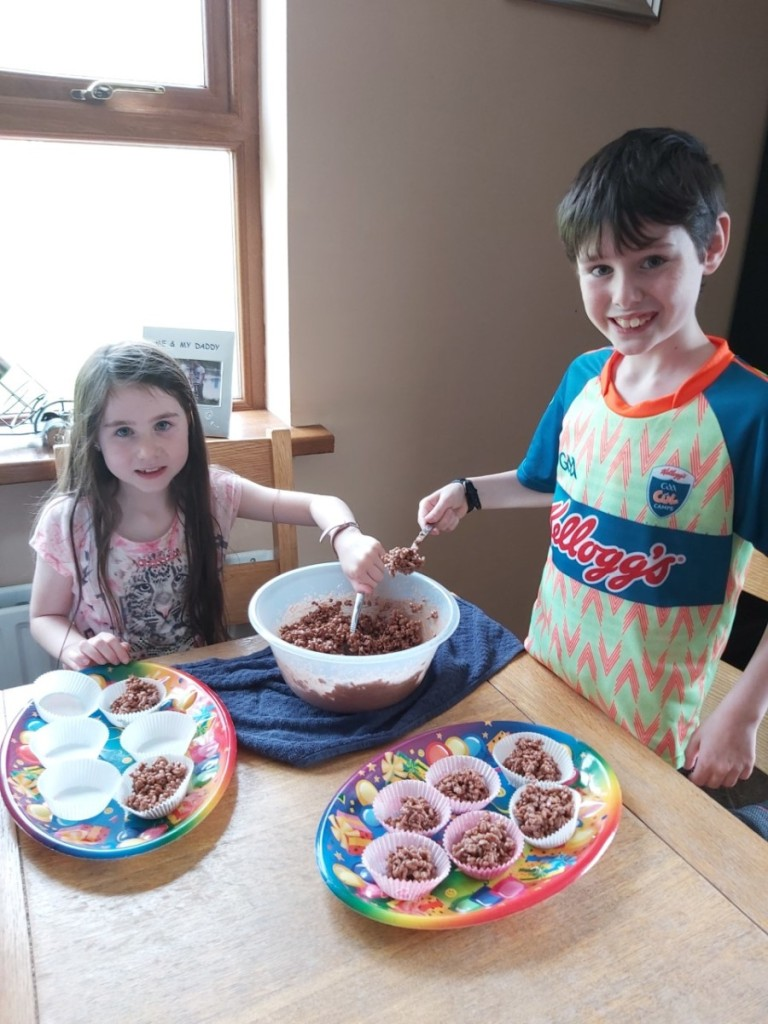 Lauren and James making rice krispies buns.