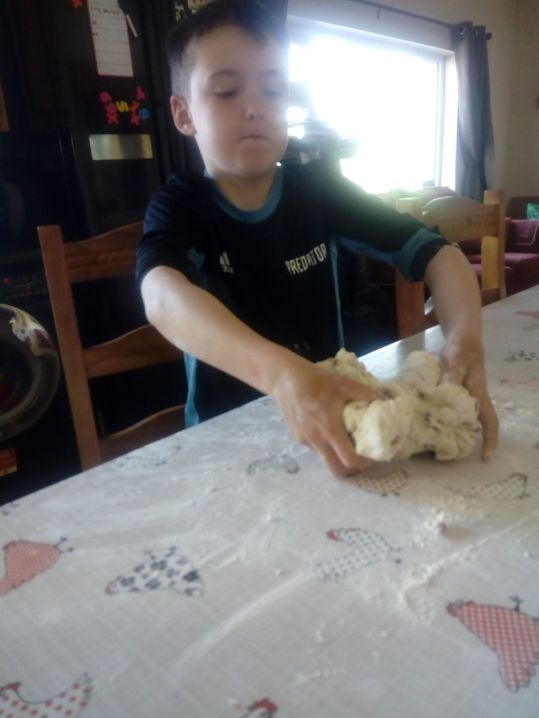 Tomás making homemade bread